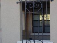 wrought-iron-bars-on-the-windows-9