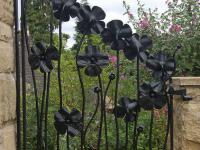 wrought-iron-little-gate-flowers